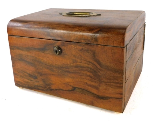 A Victorian walnut jewellery box, with an inset engraved brass handle to the hinged lid, the interior lined in leather and fitted with velvet hinged compartments and with a Bramah lock, 30cm wide.