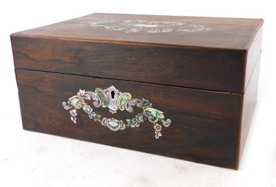 A Victorian rosewood workbox, the hinged lid inlaid with an engraved mother of pearl cartouche enclosing a vacant interior, 30cm wide.