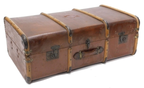 A canvas and wooden bound trunk with leather handle, 92cm wide.