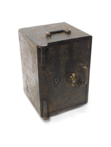 A two handled portable safe, with brass fittings, etc., 50cm wide.