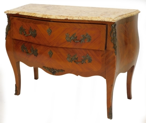 A French mahogany commode, with a serpentine shaped top with a variegated yellow marble, above two drawers, each with rococo scroll handles and mounts, on shaped legs, 84cm high, 117cm wide, 53cm deep.