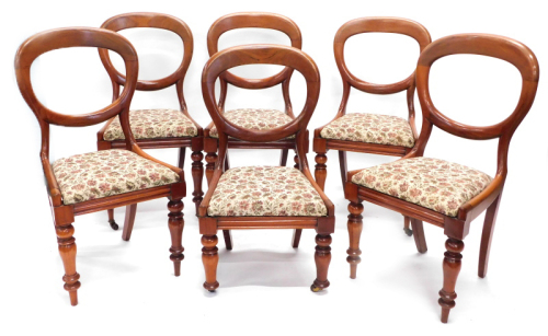 A set of six Victorian mahogany balloon back chairs, each with a drop in seat on turned legs, one reduced in height, others lacking castors, etc.