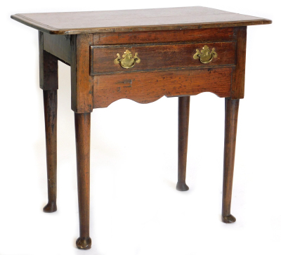 A late 18th/early 19thC oak lowboy, the top with a moulded edge above a frieze drawer, on turned tapering legs with pad feet, 79cm wide.