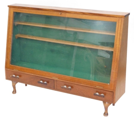 A mahogany display case, with a glazed door above two drawers, on short cabriole legs, 94cm high, 128cm wide.