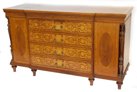 A late 19th/early 20thC continental and marquetry breakfront sideboard, the top with a rosewood crossbanded border above three drawers, each profusely inlaid with scrolls, flowers, etc., and with brass drop handles flanked by two doors and two turned and