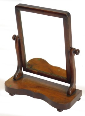 A Victorian mahogany dressing table mirror, with rectangular plate on a shaped base, 45cm wide.