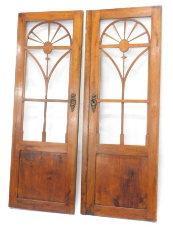 A pair of continental mahogany wardrobe doors, each with glazed central section above a panel, 152cm high, 60cm x 56cm wide respectively.