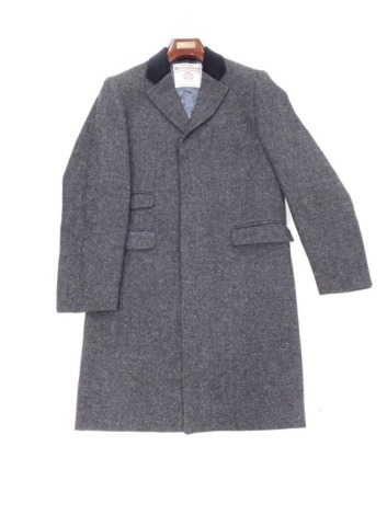 A Harris tweed coat, size small with original packaging.