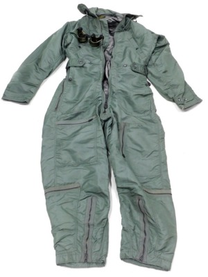 A men's flying coverall, size small/long, type CWU-I-P, made by Skyway Clothing incorporation, and an associated pair of flying type goggles.