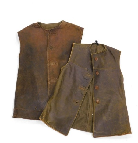 An army issue leather jerkin, size 1, label for M Belmont and Co Limited 1943, and another similar. (2)