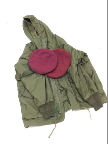 A special Air-Services green jacket, two SAS berets, sizes 6 and 5/8 and 6 and 7/8, labels for 1944 and 1945. (3)