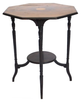 An Edwardian rosewood and ebonised occasional table, the octagonal top inlay centrally with a patera, on turned supports with under tier, 59cm wide.