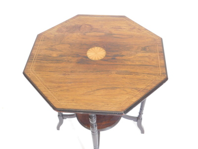 An Edwardian rosewood and ebonised occasional table, the octagonal top inlay centrally with a patera, on turned supports with under tier, 59cm wide. - 2