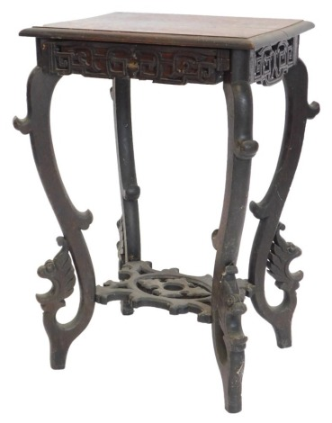 A late 19thC oak occasional table in oriental style, the rectangular top with a moulded edge above a pierced frieze, with single drawer on shaped legs with under tier, 77cm high, 54cm wide.