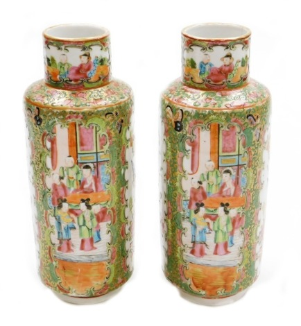 A pair of Chinese Canton vases, each with panels of figures, birds and flowers on a gilt and green flowered ground, 19thC, 26cm high.