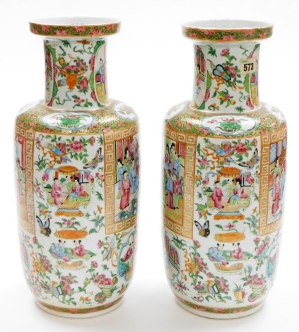 A pair of 19thC Chinese Canton porcelain baluster vases, with scenes of figures at court within a key fret border and background of various butterflies, 44cm high. (AF - minor restoration) Provenance: 1988 Lyall & Co sale at The Bourne Auction Rooms of th