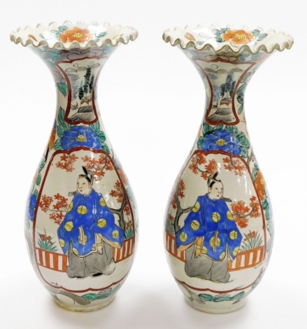 A pair of Japanese porcelain ovoid vases, with frill necks, decorated with enamelled panels of standing figures all within a floral background, Meiji period, 36cm high.