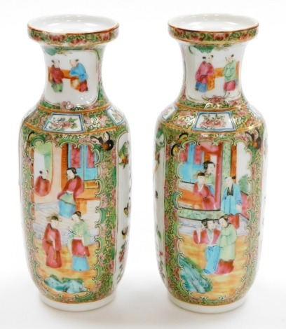 A pair of 19thC Chinese Canton porcelain baluster vases, with panels of figures at court, panels of birds and butterflies the background of flowers, birds and butterflies, 25cm high.