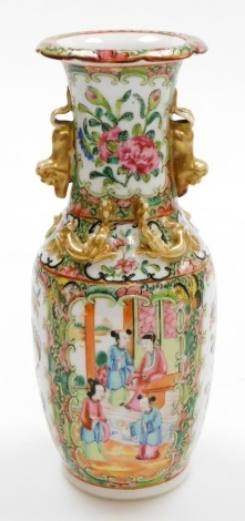 A 19thC Chinese Canton porcelain baluster vase, decorated with panels of figures at leisure and opposing panels of flowers and butterflies, applied gilt chilin to the shoulders, dog of fo handles and frilled neck, 25cm high.