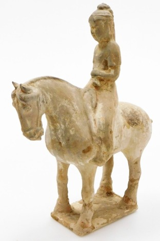 A Chinese Tang style pottery figure of a man on horseback, rectangular base, probably of the period, 30cm high.