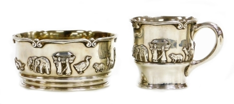 A George V silver christening set, with bowl and tankard, each decorated with Noah's Ark figures, stamped Barrett and Sons of Piccadilly, Birmingham import marks 1924, the bowl 1922, the tankard 7cm high, the bowl 11cm wide, 10¼oz.