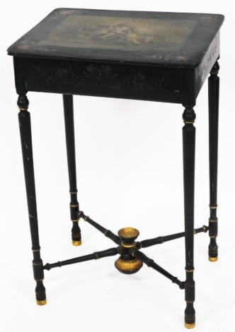A 19thC French parcel gilt and ebonised work table, with en grisaille painted top of cherubs, and rose outer border, on X frame cross base, 69cm high, 45cm wide, 35cm deep.