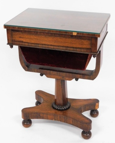 A Victorian rosewood sewing table, with side slide drawer and red velvet draw bag on a quatrefoil base, terminating in bun feet, 73cm high, 55cm wide, 36cm deep.