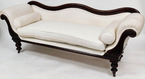 A Victorian mahogany framed sofa, with serpentine shaped moulded back, with carved scrolling arms on turned legs and casters, with loose seat cushions and re-upholstered in white woven material, 73cm high, 200cm wide, 60cm deep.