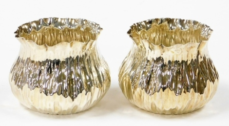 A pair of Victorian Arts & Crafts sugar bowls, each in the form of a pinched bag, London 1890, 7cm high, 7¾oz. (2)