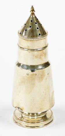 A George V Art Deco conical silver sugar castor, Birmingham 1935, 17cm high, 2¾oz. (AF)