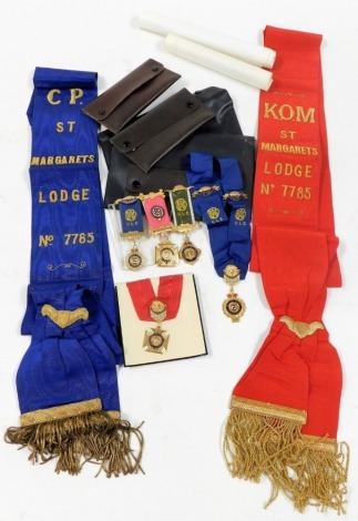 A group of Masonic memorabilia, comprising two induction certificates, red medal and sash, blue sash and medal, and three medals two for St Margaret's Lodge 7785, and another marked 2nd December 4-4-77, etc.