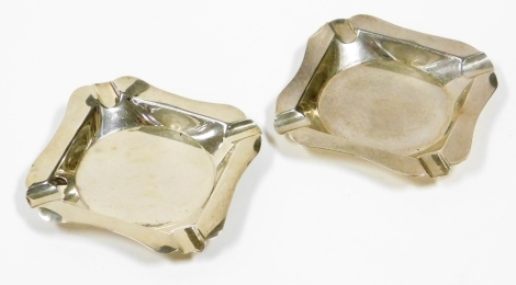A pair of Edward VII silver ashtrays, each of plain square design with maker Carr of Sheffield, London 1936, 2oz. (2)