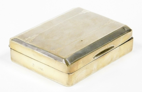 A George V silver cigarette box, with engine turned decorated top and a cedar interior, Birmingham 1931, 12cm x 9cm, 9¾oz gross.
