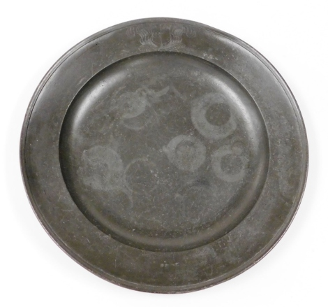 A large early 19thC pewter charger, with shielded feathers, probably continental, partial touch mark, 56cm diameter.