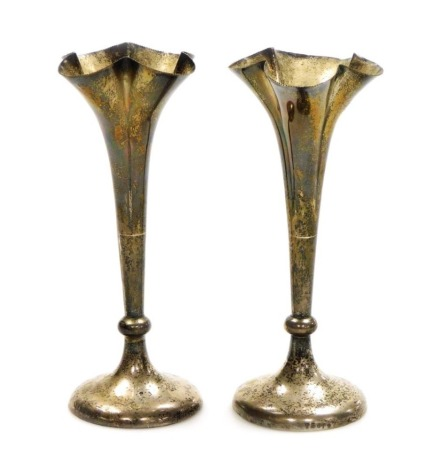 A pair of George V silver bud vases, each with fluted stem on a weighted base, London 1921, 14cm high, 15oz gross.