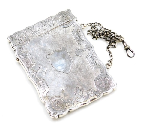 A Victorian silver card case, with chased detailing, vacant cartouche and carry chain, Birmingham 1878, 2oz.