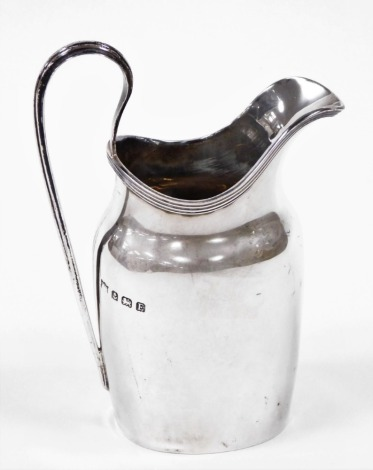 A George V silver cream jug, of Neo Classical design with loop handle, Birmingham 1929, 4¼oz.