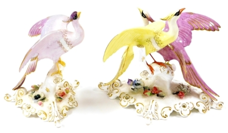 Two Royal Crown Derby bird figures, each with pink stamp to underside, to include the Chelsea Adira, 16cm high, and a twin group of Chelsea birds, 15cm high. (2)
