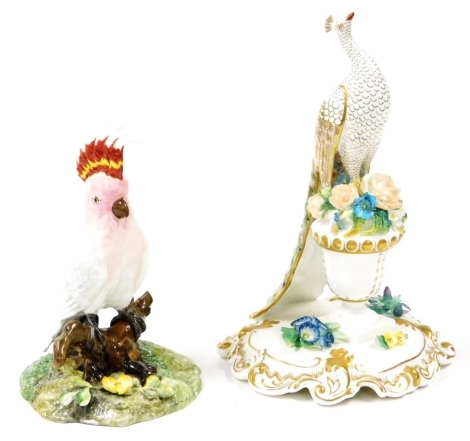 Two Royal Crown Derby bird figures, to include a peacock, signed by S P Slack and Lin Boole, 25cm high, and a Cockatoo, 18cm high. (2)
