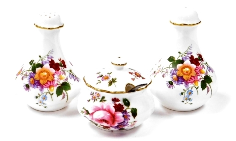 Royal Crown Derby porcelain, to include a pair of salt and pepper pots and a Derby Posies jar and cover with a silver spoon.