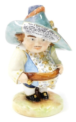 A Royal Crown Derby Mansion House dwarf, the hat bearing inscription for the auction of Elegant Household Furniture on the premises of John Humble, bears faint initials but rubbed, 18cm high.