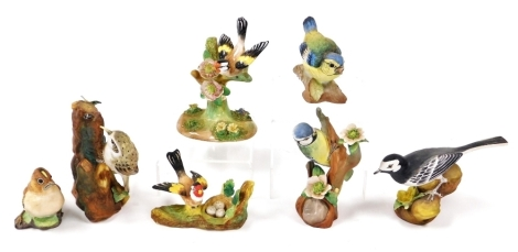 A group of Crown Staffordshire bird ornaments, to include goldfinch, blue tit, blue tit number 270, pied wagtail, goldfinch, gold crested wren and tree creeper, some signed J. Bromley. (7)