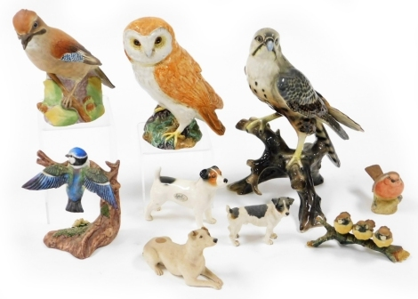 A group of various animal ornaments, to include a Capodimonte figure of three birds on a branch, an Aynsley robin, a Renaissance blue tit figure group a Sylvac dog, a large Beswick owl, a Royal Worcester jay and a large figure of a bird perched on a branc