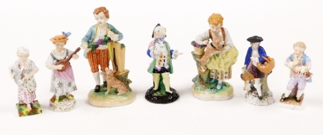 A group of Continental porcelain figures, some Dresden, to include a Dresden figure of a female playing mandolin 13cm high, a pair of girl and boy with dog figure groups 15cm high, a figure of a child playing flute (AF) 11cm high stamped Dresden, and thre
