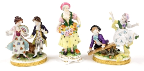 Three porcelain figure groups, to include a girl and boy on a seesaw, a girl and boy dancing, unmarked and a Derby style figure of a lady flower seller, 16cm high, 14cm high and 17cm high respectively.