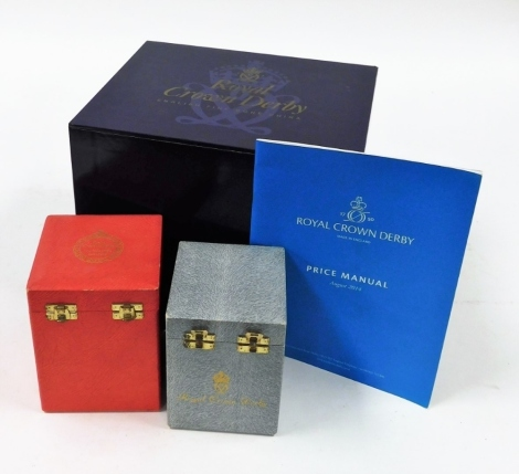 Three Royal Crown Derby boxes and a 2014 price manual. (4)