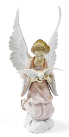 A Lladro figure of an angel holding a dove, 30cm high.