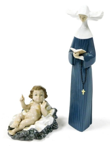 Two Lladro figures, to include a seated child and flared rock base, 12cm wide, and a nun, 25cm high. (2)