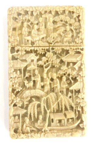 A 19thC Chinese carved ivory card case, decorated with figures, buildings, bridge, flowers, etc., 11cm high, 6.5cm wide.