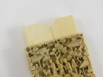 A 19thC Chinese carved ivory card case, decorated with figures, buildings, bridge, flowers, etc., 11cm high, 6.5cm wide. - 3